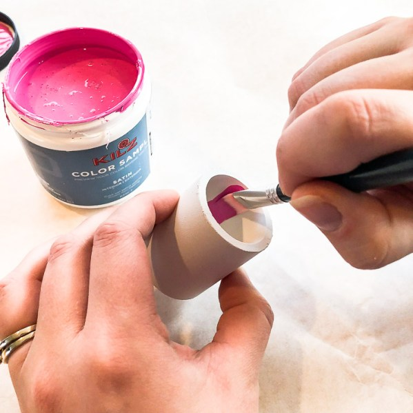 Carefully paint the inside of each pipe with bright pink paint.