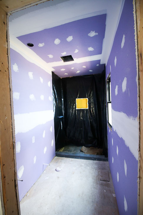 purple drywall in master shower