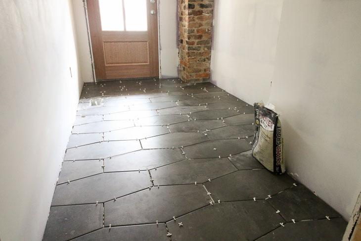 Installed Castle Rock Hex tiles gray in mudroom floor