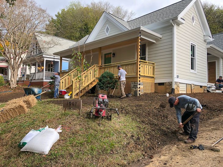 landscaper crew adding mulch and plantings