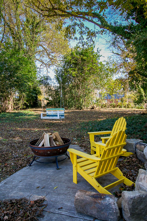 yellow adirondack chairs around fire pit