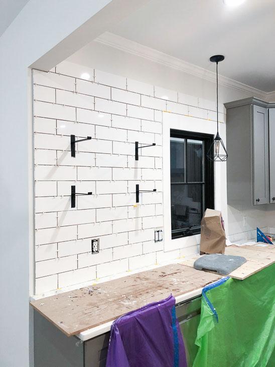 subway tile backsplash being installed