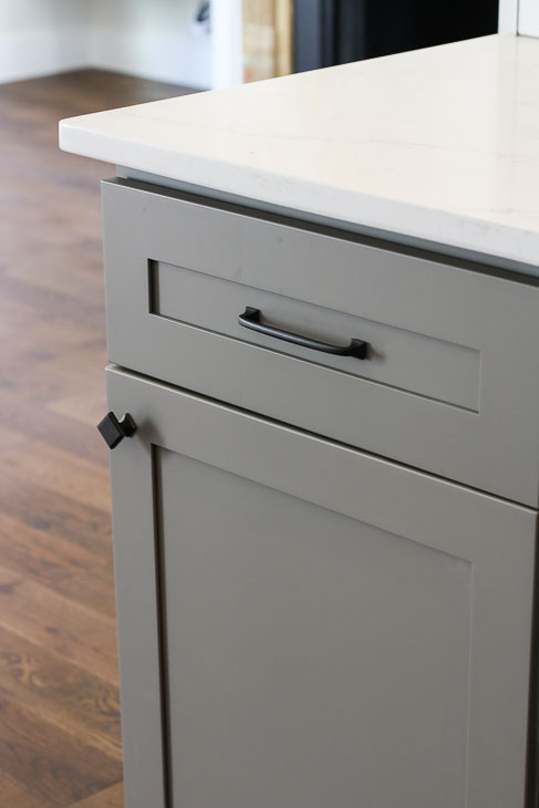 Liberty Classic Square and Lombard pull on gray shaker cabinet
