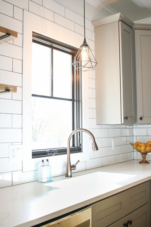 Plygem mira window with facet pendant light and subway tile