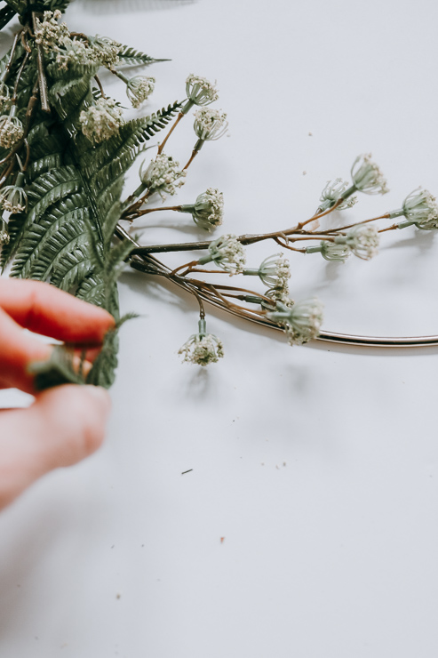 Use greenery to help hide the floral wire on your hoop wreath
