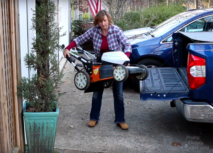Brittany lifting mower into truck unassisted