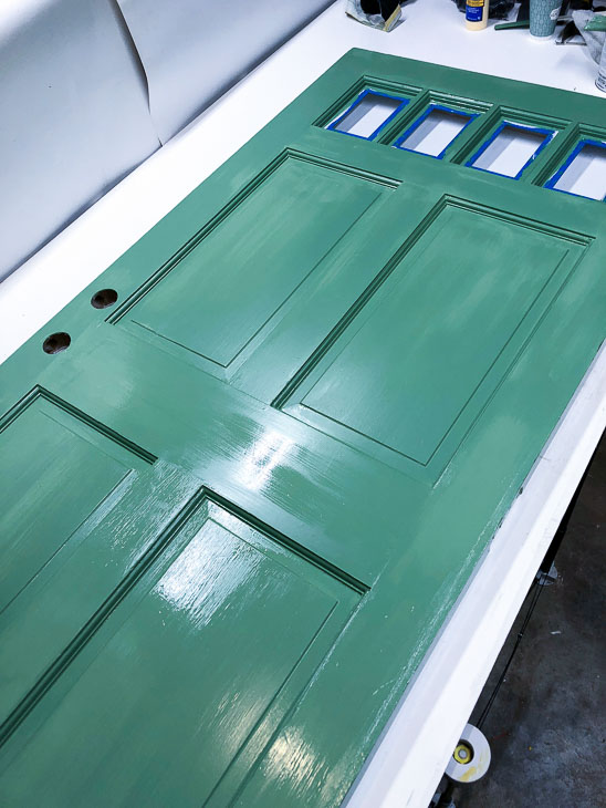 Paint repaired door with Magnolia Home Magnolia Green paint