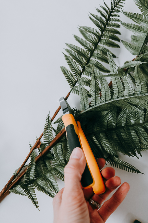 Snip off individual greens and leaves before attaching to your wreath