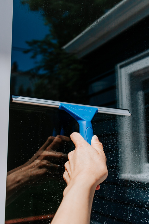 Squeegee water and soap from your windows