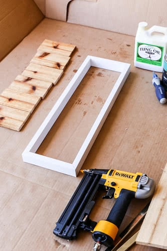 white wood frame for house numbers