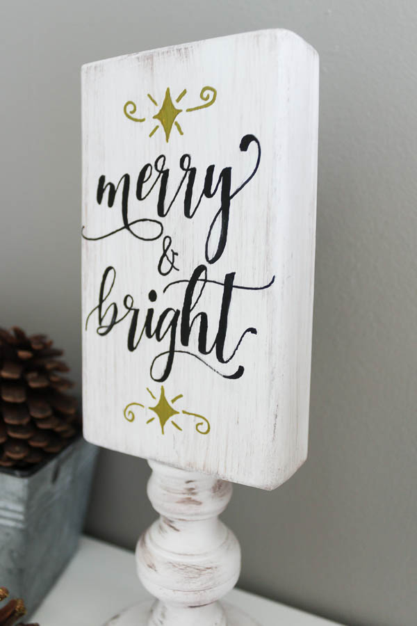 Merry and bright side on reversible wooden sign up close