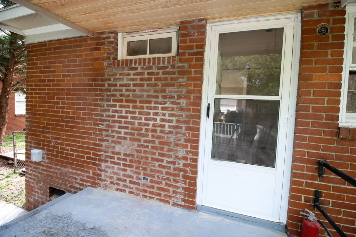 back door bricked up with transom window installed