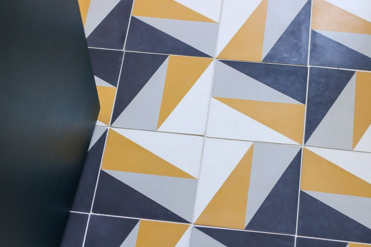 Lili Cement Tile Vegas3 houndstooth pattern gold and black tiles