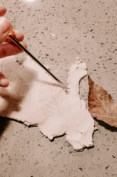 cutting out leaves from clay