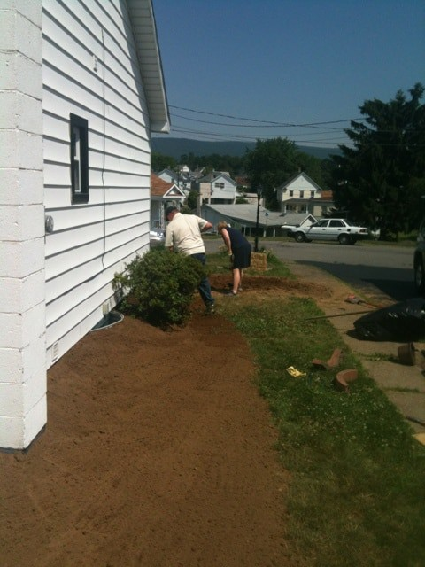 Rake the dirt to change the slope: Yard Grading 101