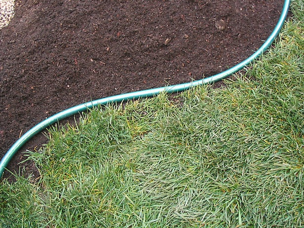 stone edging layout with a hose