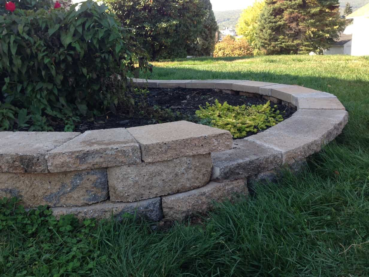 Cut stone caps for a curved retaining wall pretty purple door cut stone cap workwithnaturefo