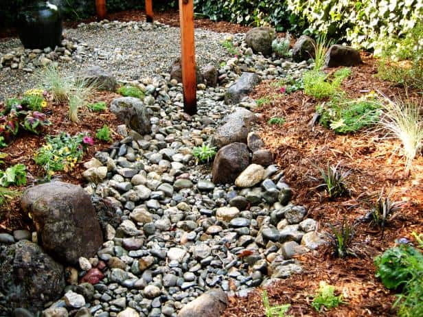 Create a dry creek bed french drain