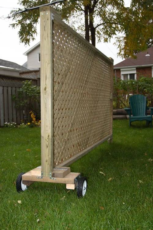 Mobile rolling privacy screen to block out second story neighbors
