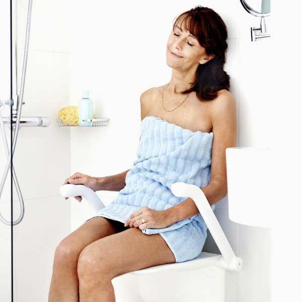 Shower seat - etac - wall mounted - user sitting relaxing