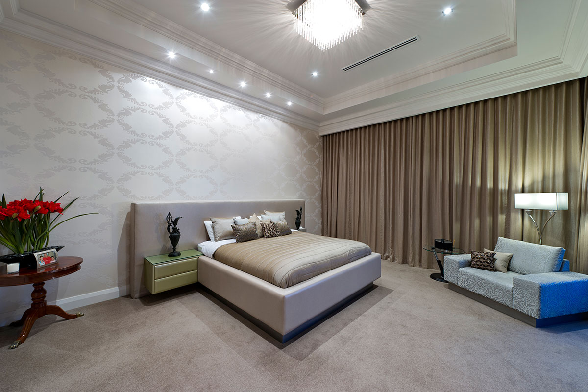 Huge bedroom with luxury curtains, carpets, ceiling mouldings, wallpaper in South perth multi level custom built home by prima designer homes