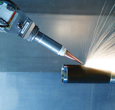 LASERDYNE 430BD laser system equipped with a fiber laser and a rotary table processing components for aerospace engines.