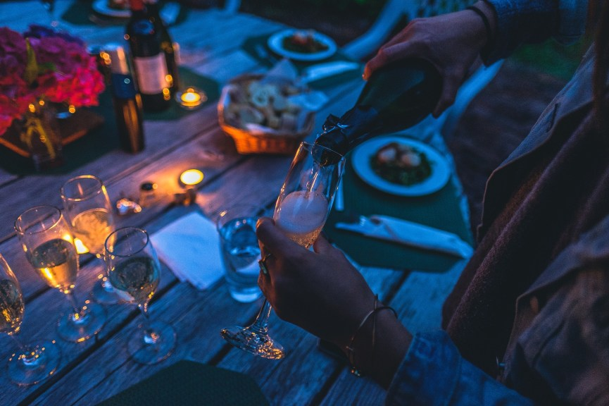 An outdoor dinner party with wine.