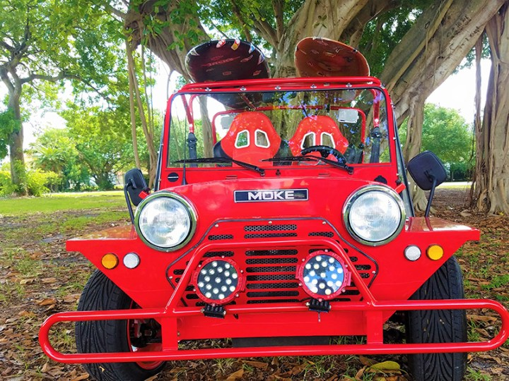 front view of a moke red golf car