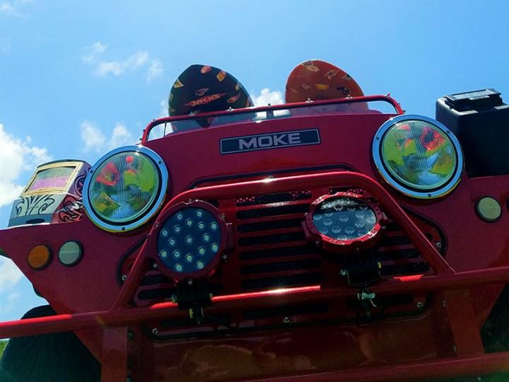custom lights on a red moke golf car