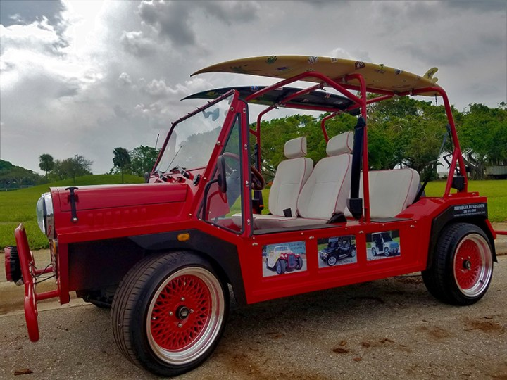 red moke golf car with white seats