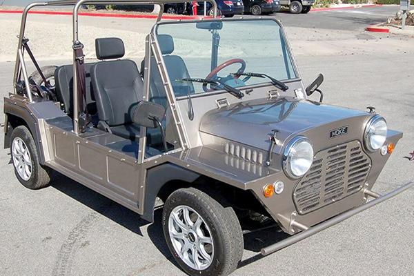 silver moke car with black seats