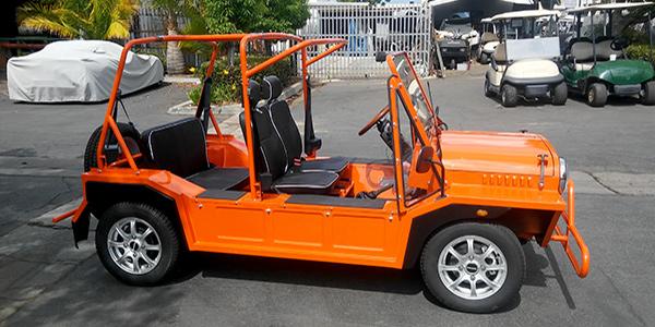 orange moke golf car with black seats