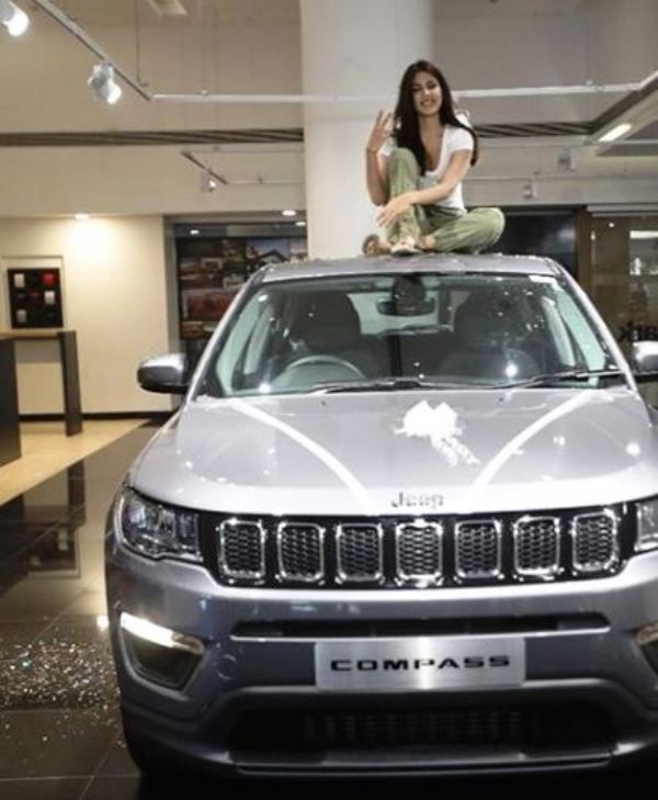 Rhea Chakraborty with Jeep compass