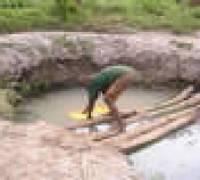 a man drawing village water wale