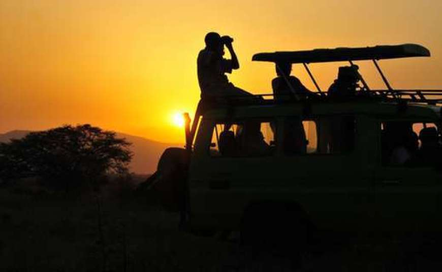 A sunset Uganda wildlife safari game drive in Kidepo
