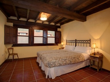 Bedroom in the holiday house for 10 people in Llanes
