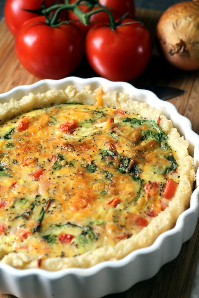 Spinach, onion and tomato quiche with sadza crust