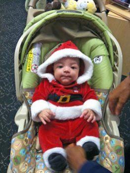 Elijah in a Santa suit