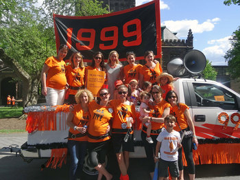 Classmates pose with the Reunions float