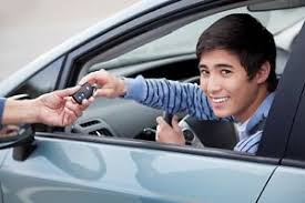 driver handing over key to another