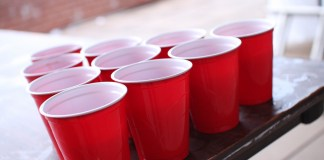 Beer pong cups on a table.