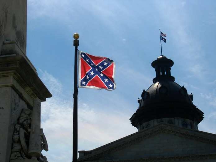 A photo of a confederate flag flying over Columbia, South Carolina