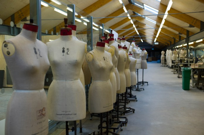 A Photo of fashion design mannequins in an empty warehouse.