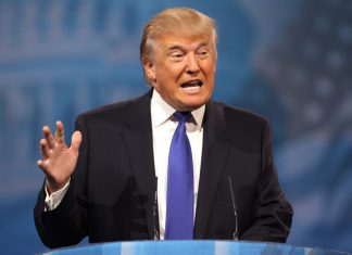 A photo of Donald Trump speaking at a conference