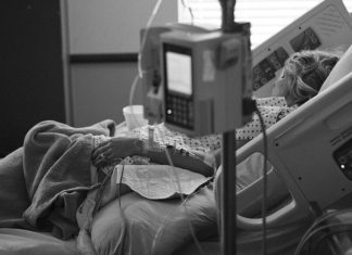 A photo of a woman in a hospital bed