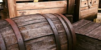 A photo of an old, weathered wooden barrel.