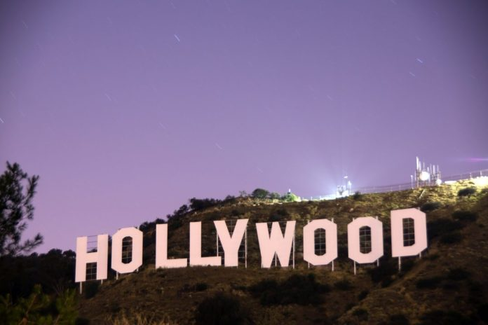A photo of the Hollywood sign at sunset.