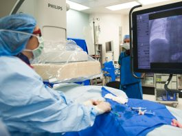 An image of a surgeon operating on a patient.