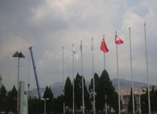 Photograph of several flagpoles, with Chinese and Hong Kong flags visible