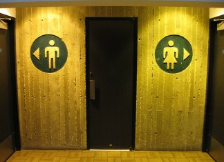 Photo of men's and women's bathroom stall signs